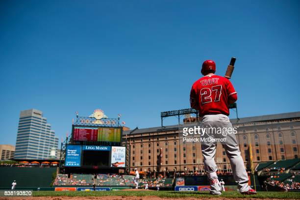 Mike Trout of the Los Angeles Angels of Anaheim stands on deck in the third inning during a game against the Baltimore Orioles at Oriole Park at...