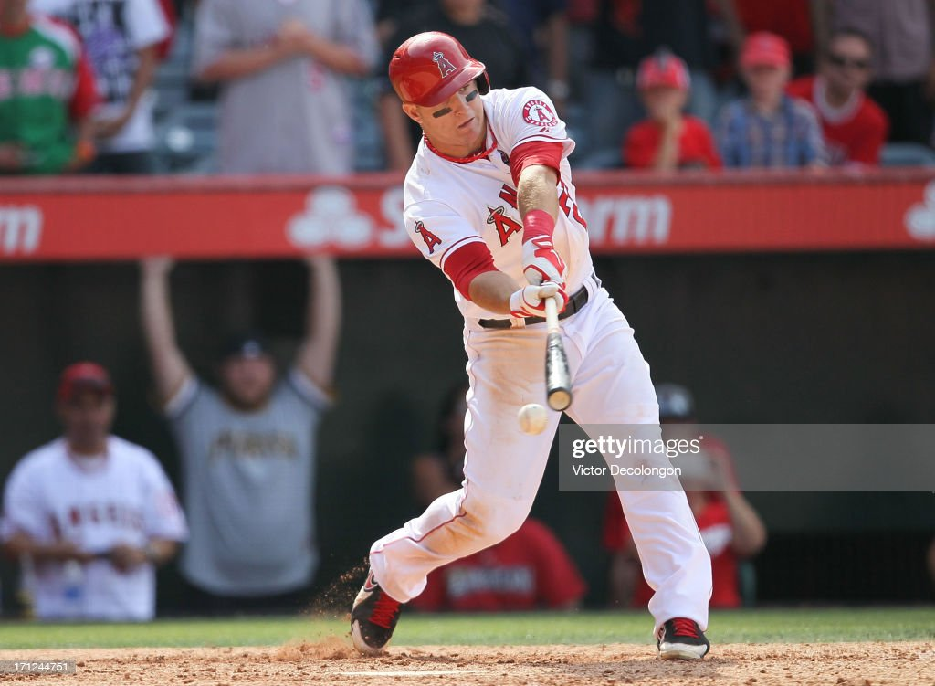 <a gi-track='captionPersonalityLinkClicked' href=/galleries/search?phrase=Mike+Trout&family=editorial&specificpeople=7091306 ng-click='$event.stopPropagation()'>Mike Trout</a> #27 of the Los Angeles Angels of Anaheim strikes out to end the game in the tenth inning in their MLB game against the Pittsburgh Pirates at Angel Stadium of Anaheim on June 23, 2013 in Anaheim, California. The Pittsburgh Pirates defeated Los Angeles Angels of Anaheim 10-9 in ten innings.
