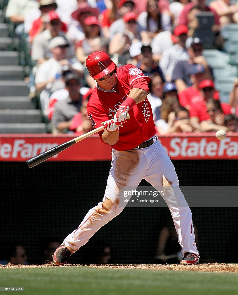 <a gi-track='captionPersonalityLinkClicked' href=/galleries/search?phrase=Mike+Trout&family=editorial&specificpeople=7091306 ng-click='$event.stopPropagation()'>Mike Trout</a> #27 of the Los Angeles Angels of Anaheim swings at a pitch and hits his first career grand slam against pitcher Rick Porcello #21 of the Detroit Tigers (not in photo) in the first inning of their MLB game at Angel Stadium of Anaheim on April 20, 2013 in Anaheim, California. The Angels defeated the Tigers 10-0.