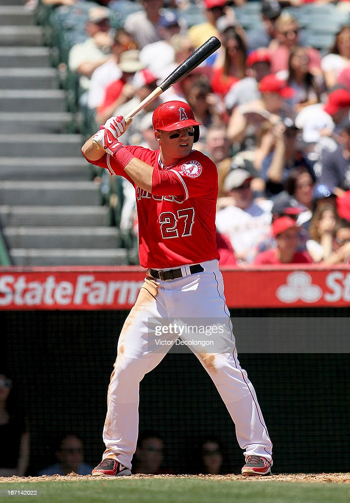 <a gi-track='captionPersonalityLinkClicked' href=/galleries/search?phrase=Mike+Trout&family=editorial&specificpeople=7091306 ng-click='$event.stopPropagation()'>Mike Trout</a> #27 of the Los Angeles Angels of Anaheim takes his second at-bat against pitcher Rick Porcello #21 of the Detroit Tigers (not in photo) in the first inning of their MLB game at Angel Stadium of Anaheim on April 20, 2013 in Anaheim, California. Trout hit a grand slam home run on this at-bat. It was Trout's first career grand slam. The Angels defeated the Tigers 10-0.