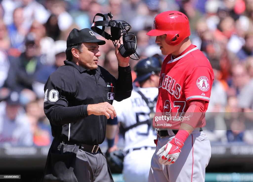 Mike Trout #27 of the Los Angeles Angels of Anaheim talks with home plate umpire Phil Cuzzi #10 after striking out in the sixth inning of the game against the Detroit Tigers at Comerica Park on April 19, 2014 in Detroit, Michigan. The Tigers defeated the Angels 5-2.