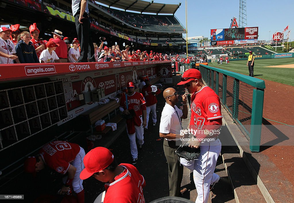 Mike Trout #27 of the Los Angeles Angels of Anaheim walks into the dugout after their MLB game against the Detroit Tigers at Angel Stadium of Anaheim on April 20, 2013 in Anaheim, California. Trout batted 2-5, scored 2 runs and hit 4 RBIs.The Angels defeated the Tigers 10-0.