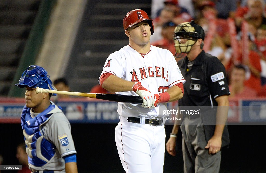 Mike Trout of the Los Angeles Angels reacts after a called strike in the eighth inning against the Kansas City Royals during Game One of the American...