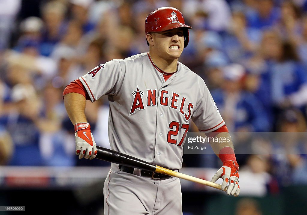 Mike Trout of the Los Angeles Angels reacts after batting against the Kansas City Royals in the third inning during Game Three of the American League...