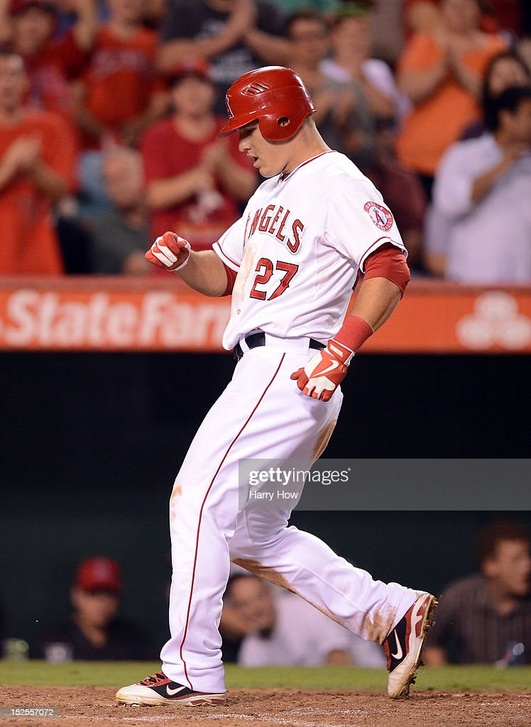 <a gi-track='captionPersonalityLinkClicked' href=/galleries/search?phrase=Mike+Trout&family=editorial&specificpeople=7091306 ng-click='$event.stopPropagation()'>Mike Trout</a> #27 of the Los Angeles Angels reacts to his homerun as he touches the plate for a 6-1 lead over the Chicago White Sox during the seventh inning at Angel Stadium of Anaheim on September 21, 2012 in Anaheim, California.