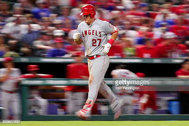 Mike Trout of the Los Angeles Angels rounds the bases after hitting a three run home run against the Texas Rangers in the top of the fifth inning at...