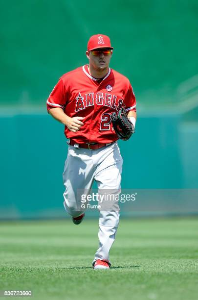 Mike Trout of the Los Angeles Angels runs in from the outfield during the game against the Washington Nationals at Nationals Park on August 16 2017...