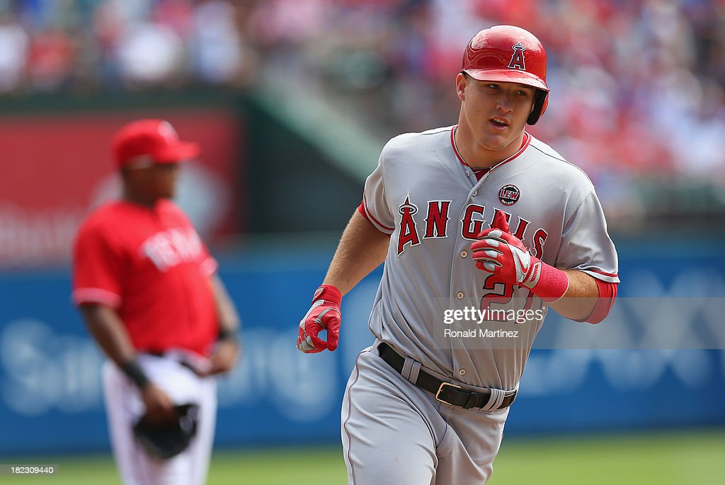 <a gi-track='captionPersonalityLinkClicked' href=/galleries/search?phrase=Mike+Trout&family=editorial&specificpeople=7091306 ng-click='$event.stopPropagation()'>Mike Trout</a> #27 of the Los Angeles Angels runs the bases after hitting a solo homerun against the Texas Rangers in the first inning at Rangers Ballpark in Arlington on September 29, 2013 in Arlington, Texas.