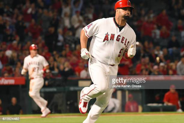 Mike Trout of the Los Angeles Angels scores on a single by Albert Pujols in the fourth inning of the game against the Toronto Blue Jays at Angel...