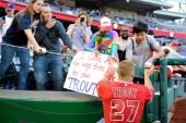 Mike Trout of the Los Angeles Angels signs autographs before the game against the Washington Nationals at Nationals Park on April 21 2014 in...