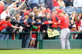 Mike Trout of the Los Angeles Angels signs autographs before the game against the Washington Nationals at Nationals Park on April 22 2014 in...