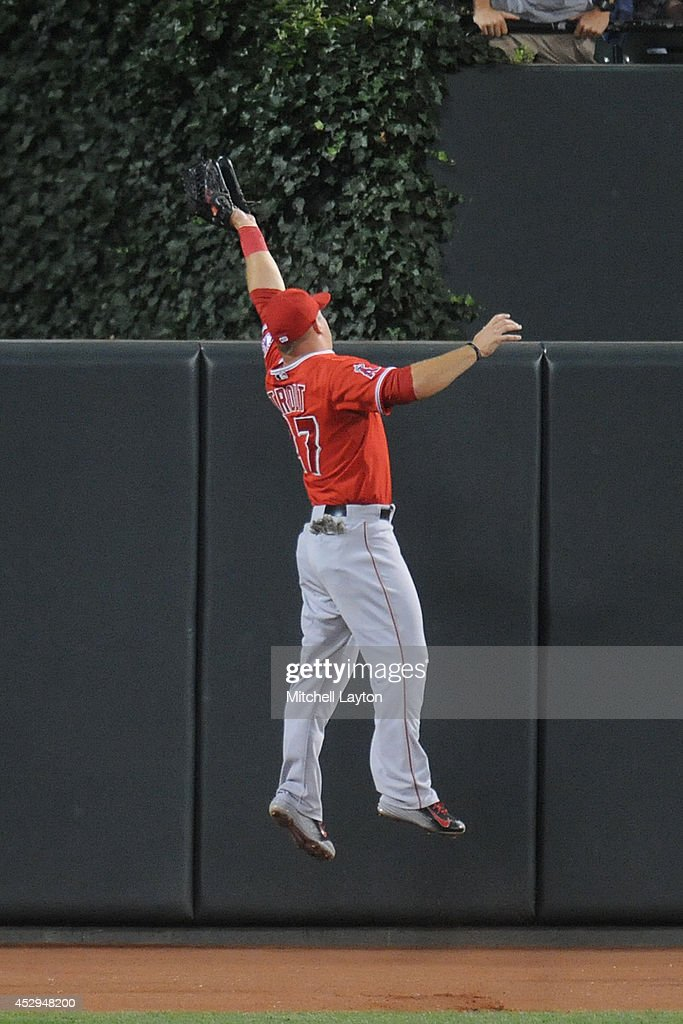 Mike Trout #27 of the Los Angeles Angels takes a home run away from Nick Markakis of the Baltimore Orioles in the fifth inning during a baseball game on July 30, 2014 at Nationals Park in Baltimore, Maryland.