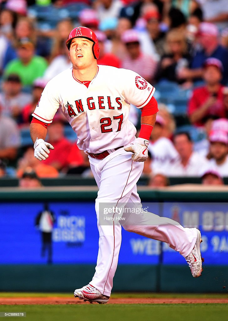 <a gi-track='captionPersonalityLinkClicked' href=/galleries/search?phrase=Mike+Trout&family=editorial&specificpeople=7091306 ng-click='$event.stopPropagation()'>Mike Trout</a> #27 of the Los Angeles Angels watches a two run homerun from Albert Pujols #5 to take a 2-1 lead over the Oakland Athletics during the first inning at Angel Stadium of Anaheim on June 24, 2016 in Anaheim, California.