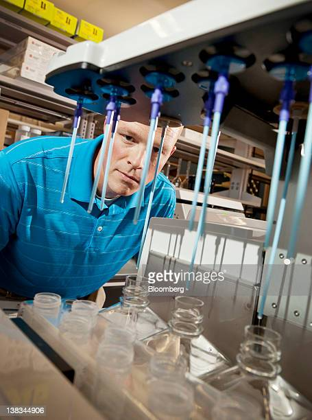 Mike Tschannen a research associate at the Medical College of Wisconsin stands beside a DNA sequencing machine in Milwaukee Wisconsin US on Tuesday...