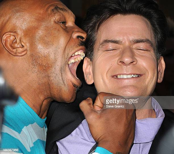 Mike Tyson and Charlie Sheen arrives at the 'Scary Movie V' Los Angeles Premiere at ArcLight Cinemas Cinerama Dome on April 11 2013 in Hollywood...