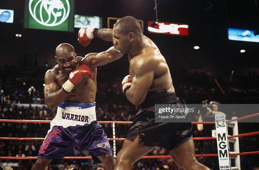 Mike Tyson and Evander Holyfield exhange punches at the MGM Grand in Las Vegas, Nevada on June 28, 1997. Tyson twice bit Evander Holyfield's ear and was disqualified in the third round.