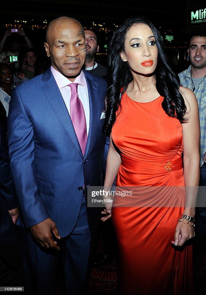 <a gi-track='captionPersonalityLinkClicked' href=/galleries/search?phrase=Mike+Tyson&family=editorial&specificpeople=194986 ng-click='$event.stopPropagation()'>Mike Tyson</a> (L) and his wife Lakiha 'Kiki' Tyson arrive at the grand opening of <a gi-track='captionPersonalityLinkClicked' href=/galleries/search?phrase=Mike+Tyson&family=editorial&specificpeople=194986 ng-click='$event.stopPropagation()'>Mike Tyson</a>'s one-man show '<a gi-track='captionPersonalityLinkClicked' href=/galleries/search?phrase=Mike+Tyson&family=editorial&specificpeople=194986 ng-click='$event.stopPropagation()'>Mike Tyson</a>: Undisputed Truth - Live on Stage' at the Hollywood Theatre at the MGM Grand Hotel/Casino April 14, 2012 in Las Vegas, Nevada.