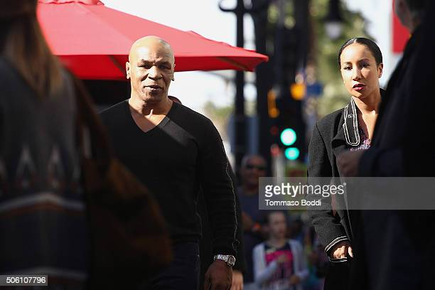 Mike Tyson and Lakiha Spicer attend a ceremony honoring Hiphop artist LL Cool J wtih a star on The Hollywood Walk Of Fame on January 21 2016 in...