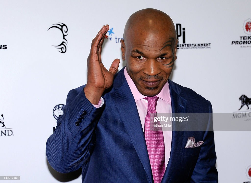 <a gi-track='captionPersonalityLinkClicked' href=/galleries/search?phrase=Mike+Tyson&family=editorial&specificpeople=194986 ng-click='$event.stopPropagation()'>Mike Tyson</a> arrives at the grand opening of his one-man show '<a gi-track='captionPersonalityLinkClicked' href=/galleries/search?phrase=Mike+Tyson&family=editorial&specificpeople=194986 ng-click='$event.stopPropagation()'>Mike Tyson</a>: Undisputed Truth - Live on Stage' at the Hollywood Theatre at the MGM Grand Hotel/Casino April 14, 2012 in Las Vegas, Nevada.
