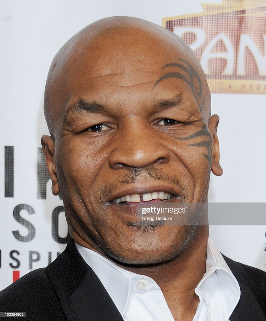 <a gi-track='captionPersonalityLinkClicked' href=/galleries/search?phrase=Mike+Tyson&family=editorial&specificpeople=194986 ng-click='$event.stopPropagation()'>Mike Tyson</a> arrives at the Los Angeles opening night of '<a gi-track='captionPersonalityLinkClicked' href=/galleries/search?phrase=Mike+Tyson&family=editorial&specificpeople=194986 ng-click='$event.stopPropagation()'>Mike Tyson</a> - Undisputed Truth' at the Pantages Theatre on March 8, 2013 in Hollywood, California.