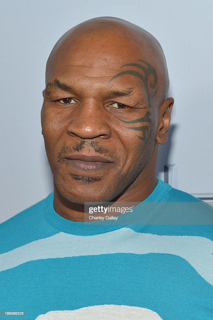 <a gi-track='captionPersonalityLinkClicked' href=/galleries/search?phrase=Mike+Tyson&family=editorial&specificpeople=194986 ng-click='$event.stopPropagation()'>Mike Tyson</a> arrives at the premiere of 'Scary Movie V' presented by Dimension Films, in partnership with Lexus and Chambord at the Cinerama Dome on April 11, 2013 in Los Angeles, California.