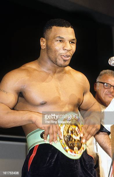 Mike Tyson celebrates as he tries on the belt after winning the fight against Trevor Berbick at Hilton Hotel in Las Vegas Nevada Mike Tyson won the...