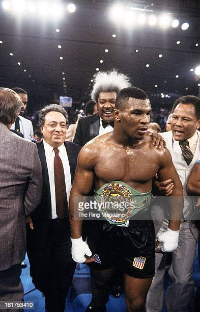 Mike Tyson celebrates with Don King as he wears the belt after winning the fight against Trevor Berbick at Hilton Hotel in Las Vegas Nevada Mike...