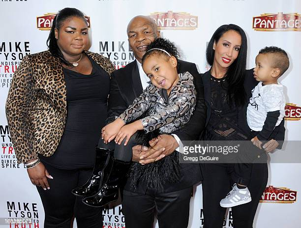 Mike Tyson daughters Mikey Tyson Milan Tyson wife Kiki Tyson and son Morocco Tyson arrive at the Los Angeles opening night of 'Mike Tyson Undisputed...