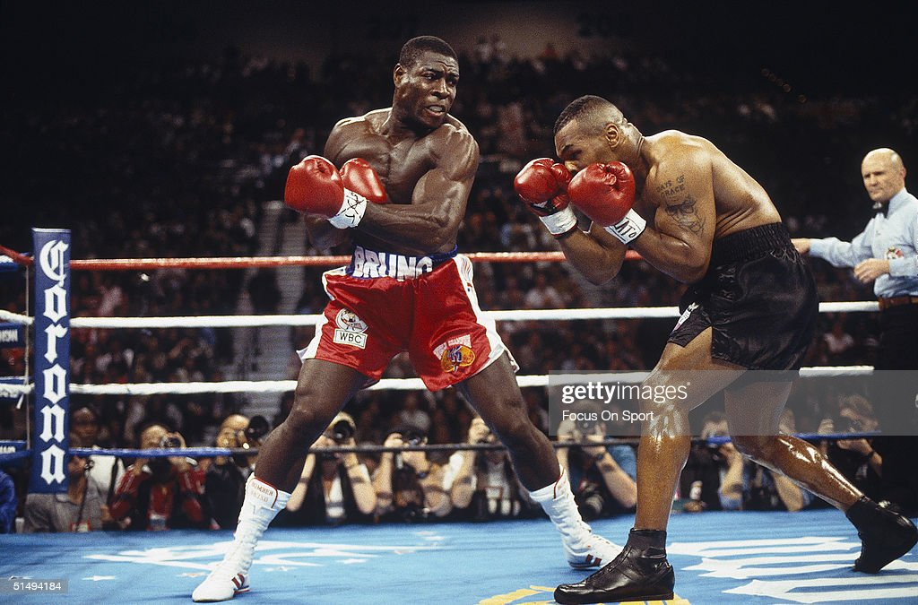Mike Tyson dodges a punch from Frank Bruno at the MGM Grand in Las Vegas, Nevada on March 3, 1996. Mike Tyson won the match with a TKO in the third round, regaining the World Boxing Council title.