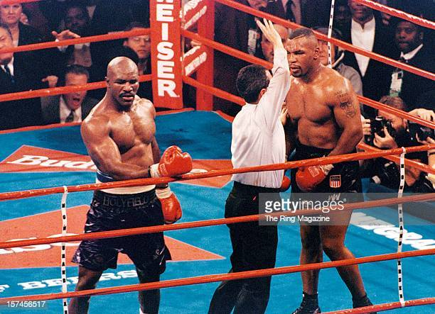 Mike Tyson is pulled away during the fight against Evander Holyfield at the MGM Grand on November 91996 in Las Vegas Nevada Evander Holyfield won by...
