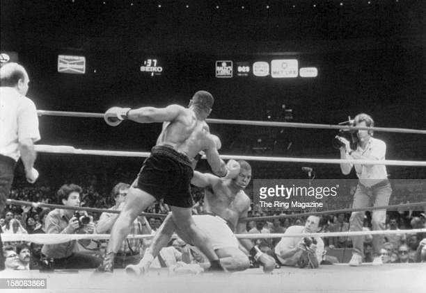 Mike Tyson lands a right punch against Reggie Gross during the fight at Madison Square Garden on June 131986 in New York New York Mike Tyson won by a...