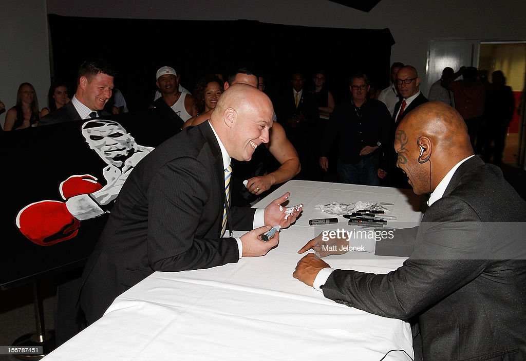 <a gi-track='captionPersonalityLinkClicked' href=/galleries/search?phrase=Mike+Tyson&family=editorial&specificpeople=194986 ng-click='$event.stopPropagation()'>Mike Tyson</a> laughs after a marker pen expolded in the hands of a member of security at a autograph signing session during his speaking tour, 'Day of the Champions' on November 21, 2012 in Perth, Australia.