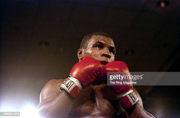 Mike Tyson looks to take a punch to Jose Ribalta during a bout at Trump Plaza Hotel on August 17 1986 in Atlantic City New JerseyMike Tyson defeated...
