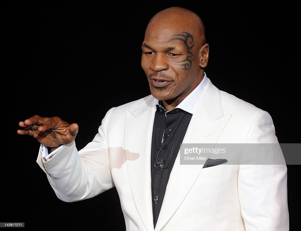 <a gi-track='captionPersonalityLinkClicked' href=/galleries/search?phrase=Mike+Tyson&family=editorial&specificpeople=194986 ng-click='$event.stopPropagation()'>Mike Tyson</a> performs during the grand opening of his one-man show '<a gi-track='captionPersonalityLinkClicked' href=/galleries/search?phrase=Mike+Tyson&family=editorial&specificpeople=194986 ng-click='$event.stopPropagation()'>Mike Tyson</a>: Undisputed Truth - Live on Stage' at the Hollywood Theatre at the MGM Grand Hotel/Casino April 14, 2012 in Las Vegas, Nevada.