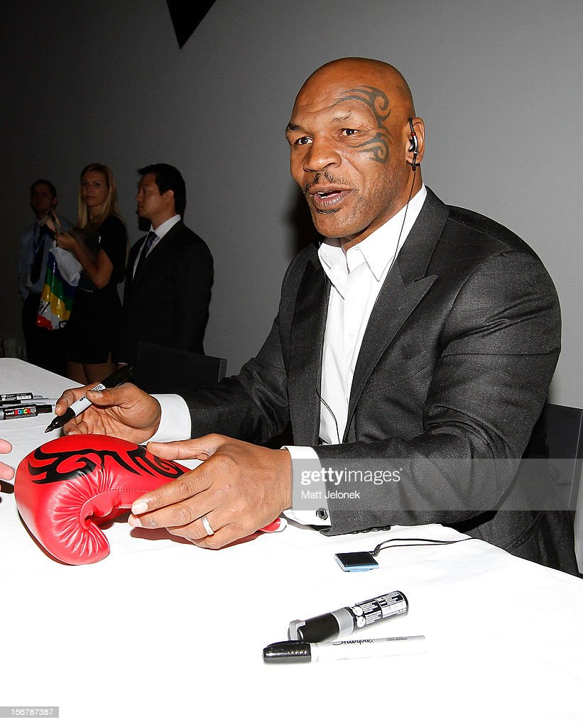 <a gi-track='captionPersonalityLinkClicked' href=/galleries/search?phrase=Mike+Tyson&family=editorial&specificpeople=194986 ng-click='$event.stopPropagation()'>Mike Tyson</a> signs autographs during his speaking tour, 'Day of the Champions' on November 21, 2012 in Perth, Australia.
