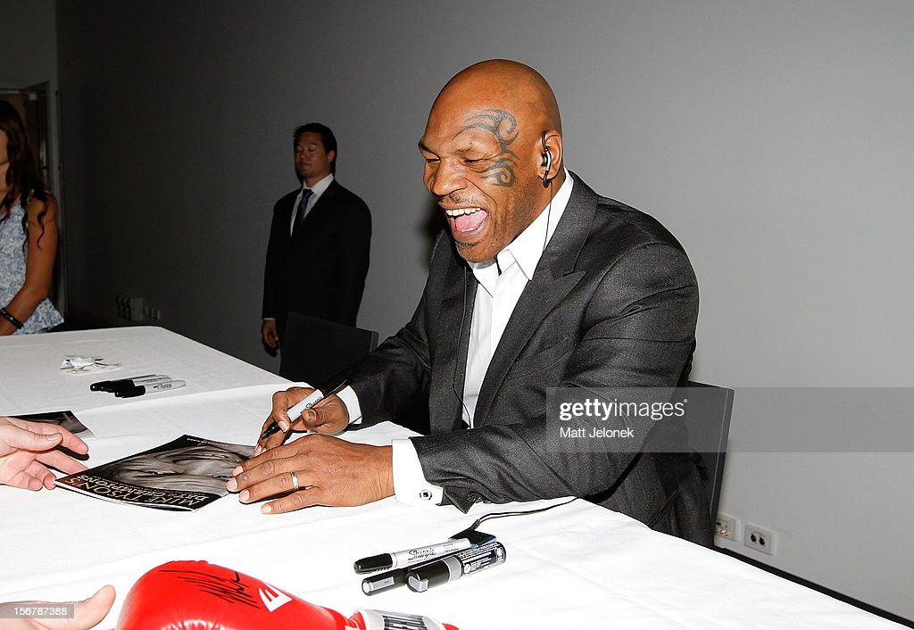 Mike Tyson signs autographs during his speaking tour, 'Day of the Champions' on November 21, 2012 in Perth, Australia.