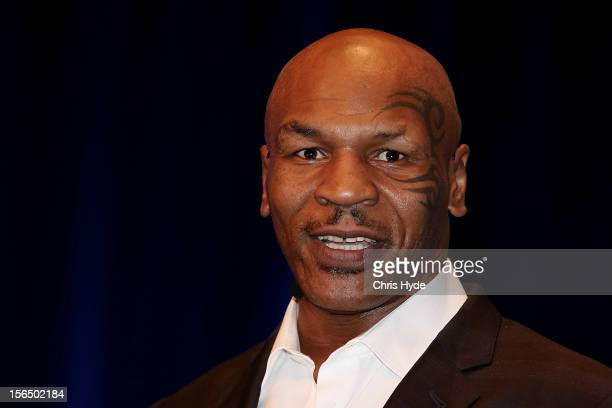 Mike Tyson speaks on stage during his speaking tour 'Day of the Champions' at the Brisbane Convention Exhibition Centre on November 16 2012 in...