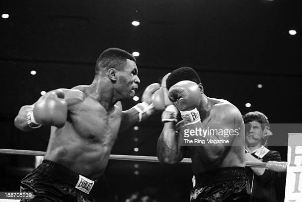 Mike Tyson throws a right hook against Trevor Berbick during the bout at Las Vegas Hilton on November 22 1986 in Las Vegas Nevada Mike Tyson won the...