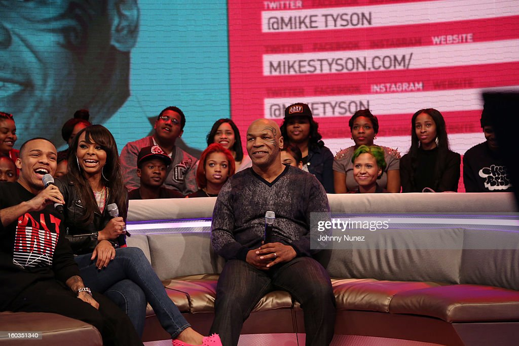 <a gi-track='captionPersonalityLinkClicked' href=/galleries/search?phrase=Mike+Tyson&family=editorial&specificpeople=194986 ng-click='$event.stopPropagation()'>Mike Tyson</a> (c) visits BET's '106 & Park' with hosts <a gi-track='captionPersonalityLinkClicked' href=/galleries/search?phrase=Bow+Wow+-+Rapper&family=editorial&specificpeople=211211 ng-click='$event.stopPropagation()'>Bow Wow</a> (L) and Kimberly 'Paigion'Walker (2nd L) at 106 & Park Studio on January 29, 2013, in New York City.