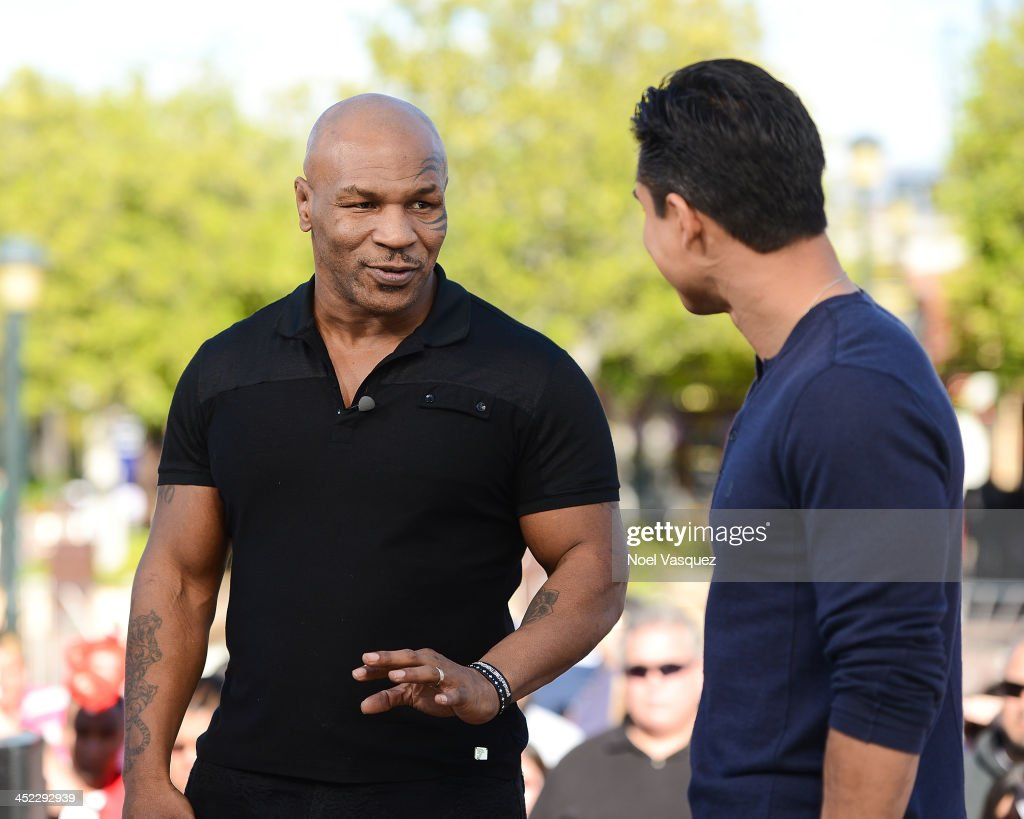 <a gi-track='captionPersonalityLinkClicked' href=/galleries/search?phrase=Mike+Tyson&family=editorial&specificpeople=194986 ng-click='$event.stopPropagation()'>Mike Tyson</a> visits 'Extra' at Universal Studios Hollywood on November 27, 2013 in Universal City, California.