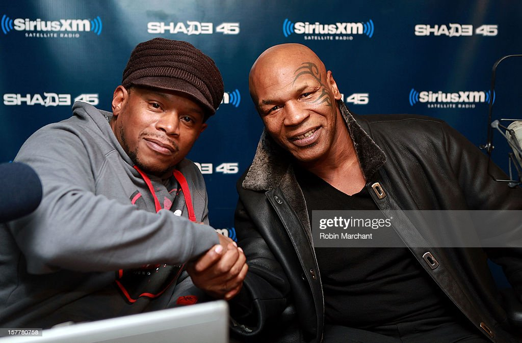 Mike Tyson visits 'Sway in the Morning' with Sway Calloway (L) on Eminem's Shade 45 the SiriusXM Studios on December 6, 2012 in New York City.