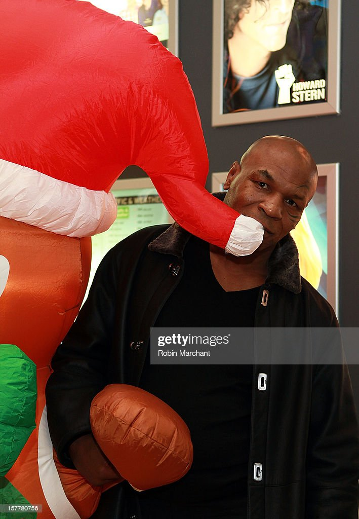 <a gi-track='captionPersonalityLinkClicked' href=/galleries/search?phrase=Mike+Tyson&family=editorial&specificpeople=194986 ng-click='$event.stopPropagation()'>Mike Tyson</a> visits the SiriusXM Studios on December 6, 2012 in New York City.