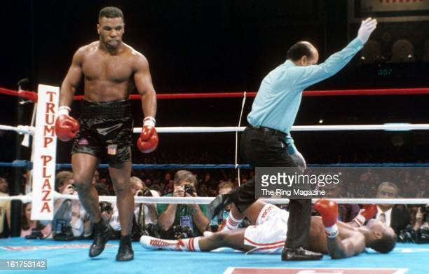 Mike Tyson walks to his corner after knocking out Larry Holmes during the fight at Convention Center in Atlantic City New Jersey Mike Tyson won the...