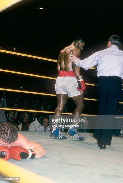 Mike Tyson walks to his corner after knocking out Steve Zouski during the fight at Nassau Coliseum in Uniondale New York Mike Tyson won by a KO 3