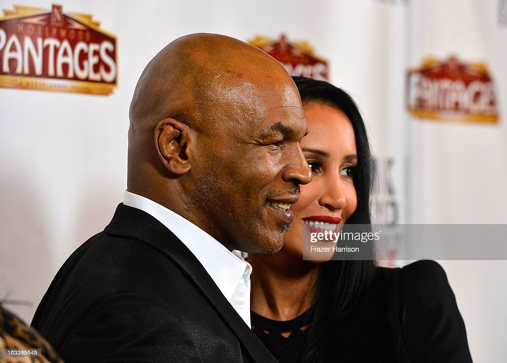 Mike Tyson with his wife Kiki Tyson arrive at the opening Night Of 'Mike Tyson: Undisputed Truth' At The Pantages Theatre at the Pantages Theatre on March 8, 2013 in Hollywood, California.