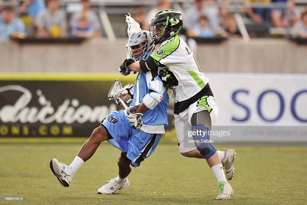 Mike Unterstein #65 of the New York Lizards attempts to wrap up Chazz Woodson #1 of the Ohio Machine in the first period on May 18, 2013 at Selby Stadium in Delaware, Ohio.