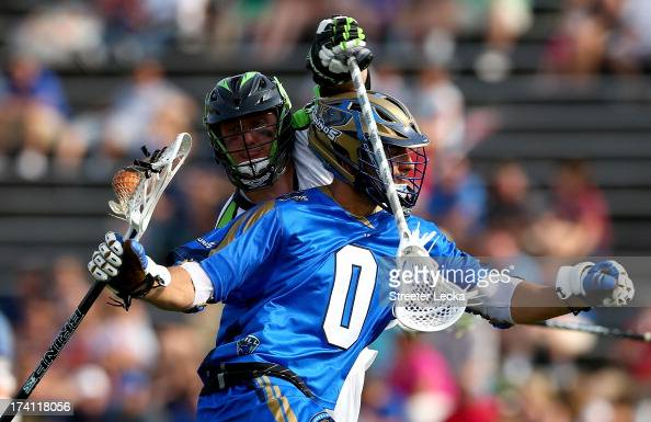 Mike Unterstein of the New York Lizards tries to stop Jake Tripuka of the Charlotte Hounds at American Legion Memorial Stadium on July 20 2013 in...