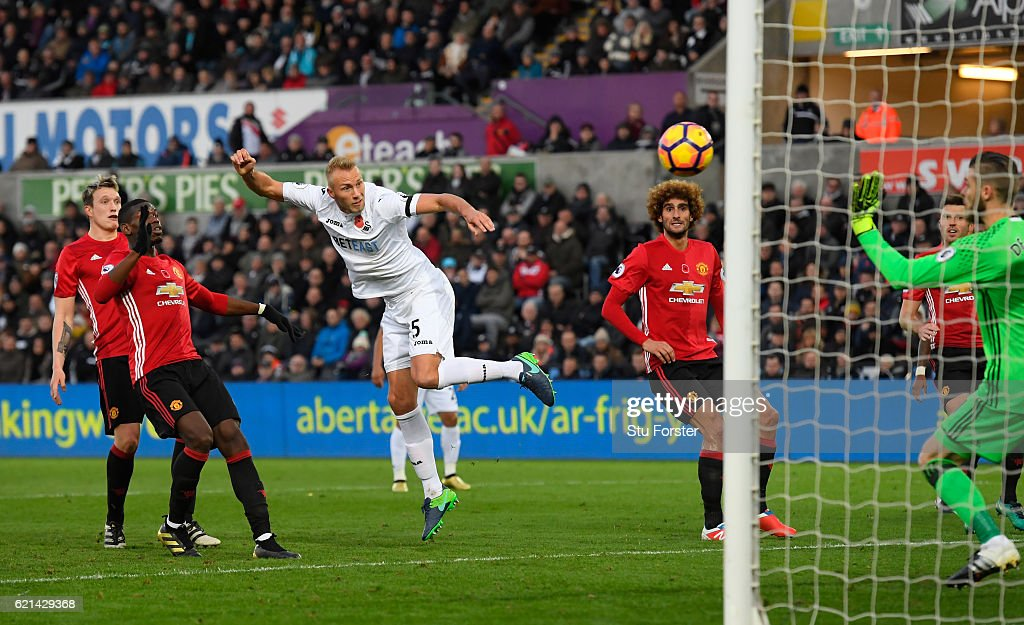 Mike van der Hoorn of Swansea City scores his sides first goal during the Premier League match between Swansea City and Manchester United at Liberty Stadium on November 6, 2016 in Swansea, Wales.
