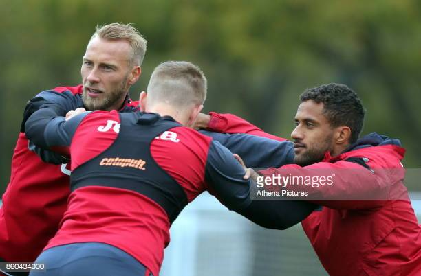 Mike van der Hoorn Sam Clucas and Wayne Routledge in action during the Swansea City Training at The Fairwood Training Ground on October 11 2017 in...