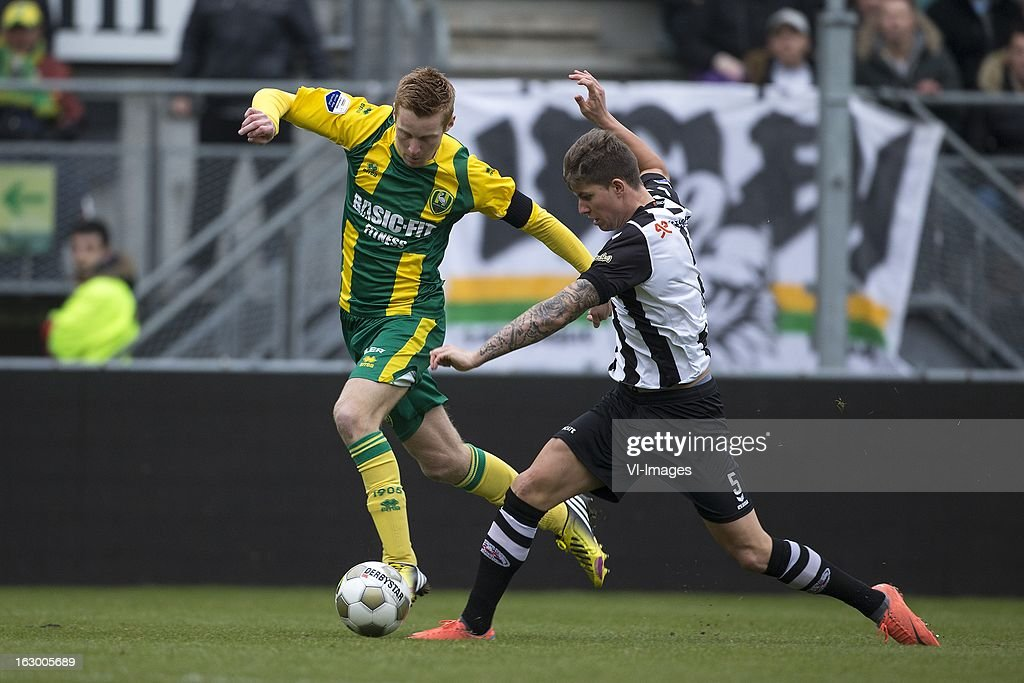 Mike van Duinen of ADO Den Haag, Christian Dorda of Heracles Almelo during the Dutch Eredivisie match between ADO Den Haag and Heracles Almelo at the Kyocera Stadium on march 03, 2013 in The Hague, The Netherlands